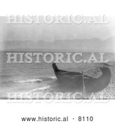 Historical Image of a Canoe on Shore at Flathead Lake, Montana 1910 - Black and White by Al