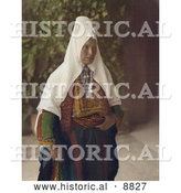 Historical Image of an Arab Woman Wearing Dowry Necklace and Traditional Clothing by Al