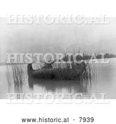 Historical Image of Kootenai Native American Indian in a Canoe, Gathering Rushes 1910 - Black and White by Al