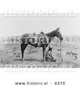 Historical Photo of a Cowboy Sitting Beside His Saddled Horse on a Hill, Overlooking Horses in Bonham, Texas, 1910 - Black and White Version by Al