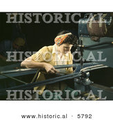 Historical Photo of a Female Riveter Riveting Metal Pieces Together by Al
