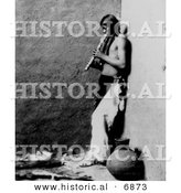 Historical Photo of a Native American Indian Playing an Instrument 1908 - Black and White Version by Al