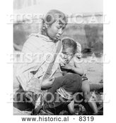 Historical Photo of Inuit Eskimo Mother Breast Feeding 1908 - Black and White Version by Al