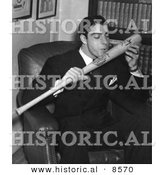 Historical Photo of New York Yankees Baseball Player, Joe Dimaggio, Kissing His Signature on a Baseball Bat, 1941 - Black and White Version by Al