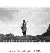 December 13th, 2013: Historical Photo of Sioux Man with Rifle and Bow 1905 - Black and White by Al