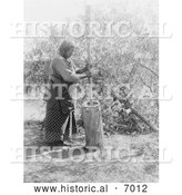 December 13th, 2013: Historical Photo of Wichita Indian Using a Mortar and Pestle 1927 - Black and White by Al