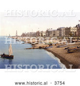 Historical Photochrom of a Man Rowing a Boat near a Beach with Boats Lined up on the Shore and Waterfront Buildings in Herne Bay Kent South East England by Al
