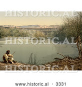 Historical Photochrom of an Arabian Man on the Shore of the River Jordan by Al