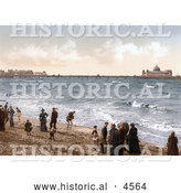 Historical Photochrom of People on the Beach Playing in the Surf near the Pier in Morecambe Lancashire England UK by Al
