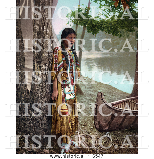 Historical Photo of Young Native American Indian Girl Posing Against a Tree Beside a Boat on a River Bank 1904