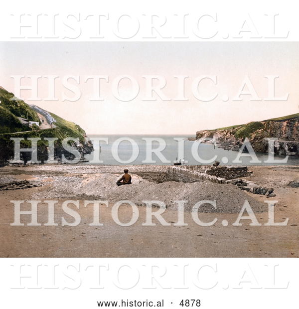 Historical Photochrom of a Man on the Beach at Port Isaac Port Gavern Cornwall England United Kingdom