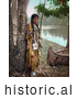 Historical Photo of Young Native American Indian Girl Posing Against a Tree Beside a Boat on a River Bank 1904 by Al