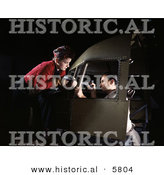 Historical Photo of a Male and Female Riveters Assembling an Airplane Together by Al