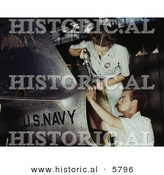 Historical Photo of a Male and Female Riveters Working on an Airplane Together by Al